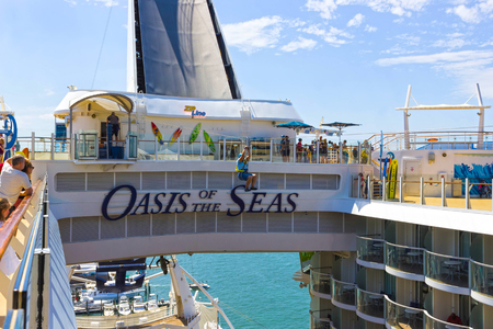 FORT LAUDERDALE, USA - APRIL 30, 2018: The passenger flying at zip line at cruise liner or ship Oasis of the Seas by Royal Caribbean
