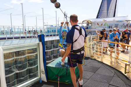 Ft. Lauderdale, USA - April 30, 2018: The passenger flying at zip line at cruise liner or ship Oasis of the Seas by Royal Caribbean