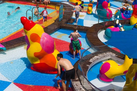 FORT LAUDERDALE, FLORIDA, USA - APRIL 29, 2018: The upper deck with childrens swimming pools at cruise liner or ship Oasis of the Seas by Royal Caribbean