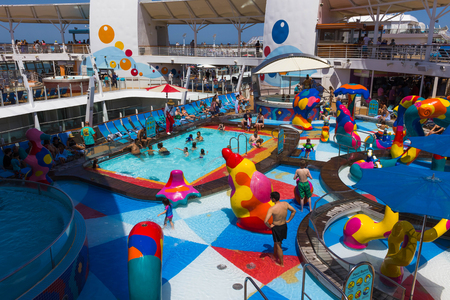 FORT LAUDERDALE, USA - APRIL 29, 2018: The upper deck with childrens swimming pools at cruise liner or ship Oasis of the Seas by Royal Caribbean