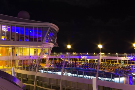 Cape Canaveral, USA - May 02, 2018: Open deck in the night time. Giant cruise ship Oasis of the Seas by Royal Caribbean.