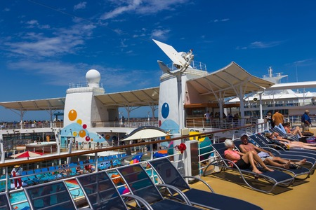 Cape Canaveral, USA - April 29, 2018: The upper deck with swimming pools at cruise liner or ship Oasis of the Seas by Royal Caribbean Editorial