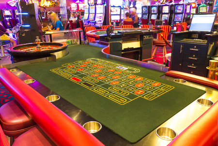 Cape Canaveral, USA - April 30, 2018: Slot machines in the casino on a cruise ship in the Caribbean Sea