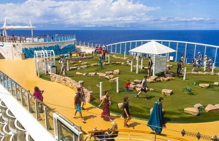 Cape Canaveral, USA - April 30, 2018: The upper deck with .mini golf court at cruise liner or ship Oasis of the Seas by Royal Caribbean Editorial