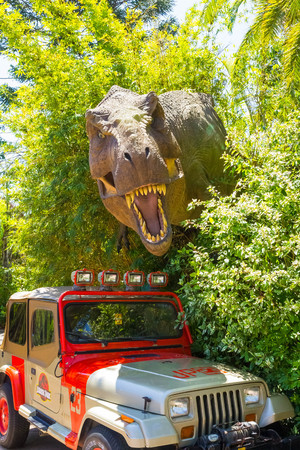 Orlando, Florida - May 09, 2018: Jurassic Park dinosaur and jeep at Universal Studios Islands of Adventure theme park