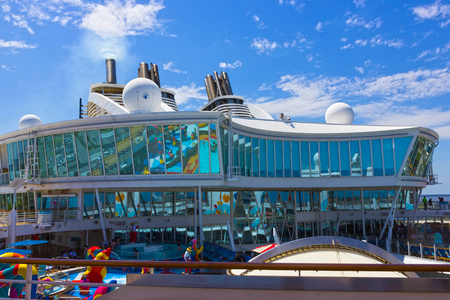 Cape Canaveral, USA - April 29, 2018: The upper deck with childrens swimming pools at cruise liner or ship Oasis of the Seas by Royal Caribbean Editorial