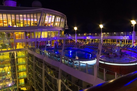 Cape Canaveral, USA - May 06, 2018: Open deck in the night time. Giant cruise ship Oasis of the Seas by Royal Caribbean.