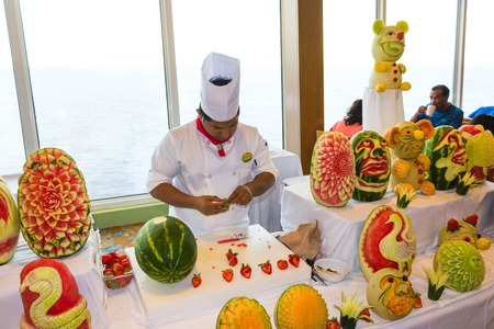 Cape Canaveral, USA - May 06, 2018: The chef presenting a culinary show on a cruise ship Oasis of the Seas by Royal Caribbean