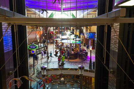 Cape Canaveral, USA - May 05, 2018: The passengers at cruise liner Oasis of the Seas by Royal Caribbean on May 05, 2018. The interier of ship with fountain