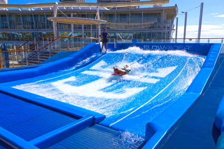 Falmouth, Jamaica - May 02, 2018: Man surfing on the FlowRider aboard the Oasis of the Seas by Royal Caribbean Editorial
