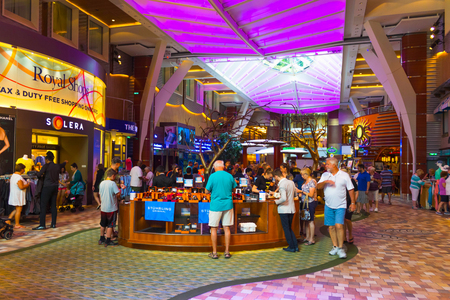 Cape Canaveral, USA - April 30, 2018: The passengers at cruise liner Oasis of the Seas by Royal Caribbean