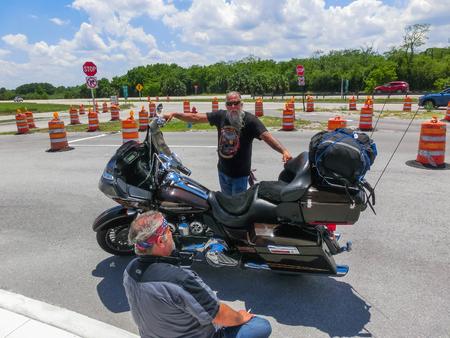 Orlando, USA - May 8, 2018: The senior Harley Davidson biker resting at Orlando, USA on May 8, 2018 Editorial