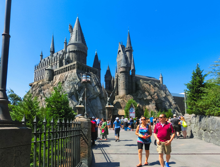 Orlando, Florida, USA - May 09, 2018: People going at The Wizarding World of Harry Potter