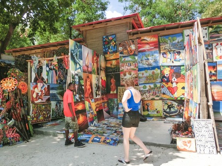 LABADEE, HAITI - MAY 01, 2018: Handcrafted Haitian souvenirs sunny day on beach at island Labadee in Haiti Redakční