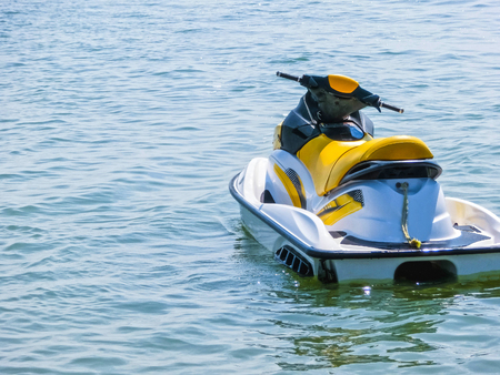 Water motorcycle in the blue sea on clear sunny day. Foto de archivo