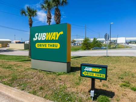 Orlando, USA - May 8, 2018: Subway logo at road. Subway is an American fast food restaurant franchise that primarily sells submarine sandwiches and salads