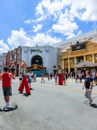ORLANDO, FLORIDA, USA - MAY 08, 2018: The man on stilts near entrance to Revenge of the Mummy ride. Universal Studios Orlando is a theme park in Orlando, Florida, USA