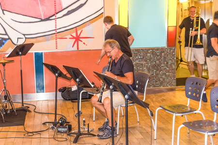 Cape Canaveral, USA - May 05, 2018: The musical jazz band on upper deck at cruise liner Oasis of the Seas by Royal Caribbean docked in Cape Canaveral, USA on May 05, 2018. Stock Photo - 106328614