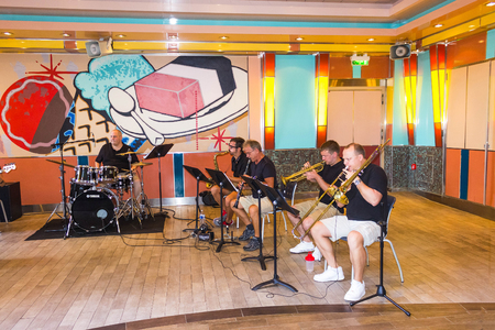 Cape Canaveral, USA - May 05, 2018: The musical jazz band on upper deck at cruise liner Oasis of the Seas by Royal Caribbean docked in Cape Canaveral, USA on May 05, 2018. Stock Photo - 106328603