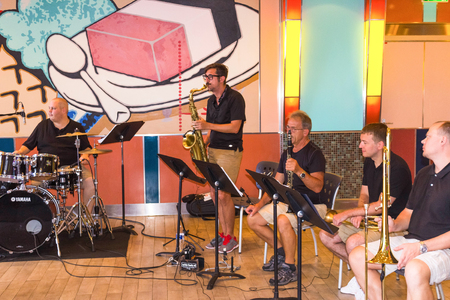 Cape Canaveral, USA - May 05, 2018: The musical jazz band on upper deck at cruise liner Oasis of the Seas by Royal Caribbean docked in Cape Canaveral, USA on May 05, 2018.