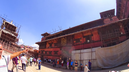 PATAN, NEPAL - April 13, 2018: People going at street in Patan, ancient city in Kathmandu Valley. Historically Patan, now Lalitpur Metropolitan City is the third largest city of Nepal.