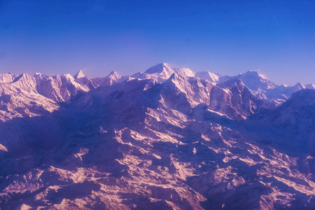Himalaya mountains in Nepal, view of small village Braga on Annapurna circuit at sunset or sunrise