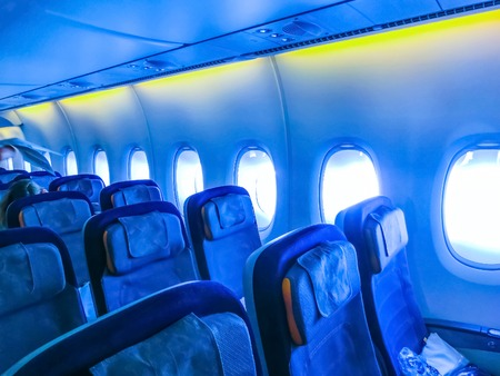 The interior of passenger airplane with the seats and screens