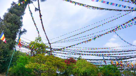 Asian holiday flags against sky at Nepal