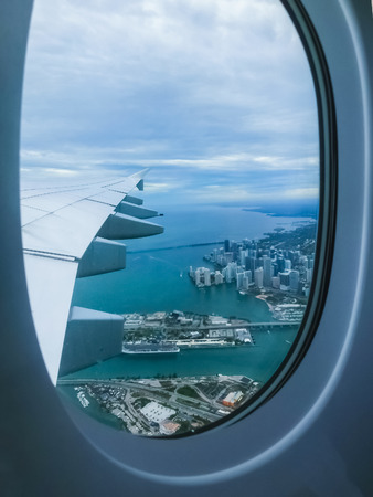 Miami Beach skyline from airplane porthole at day