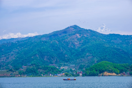 Begnas Tal, Nepal with the Annapurna Himalaya visible in the background at day