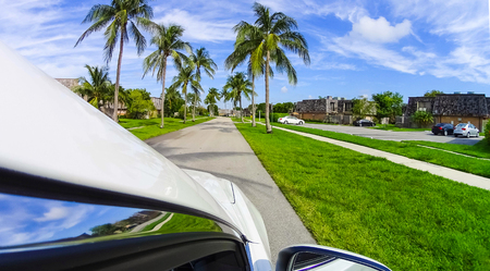 Typical Southwest Florida home in the countryside with palm trees, tropical plants and flowers. Palm Springs is a village in Palm Beach County, Florida, United States,