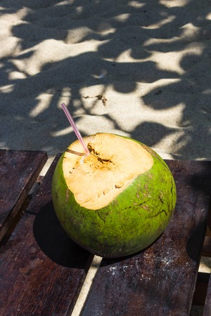 Green coconuts with drinking straw at Jamaica Stock Photo