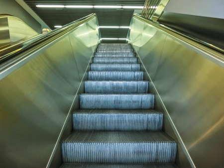 escalator in modern office center or abstract airport