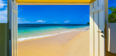 The sea and sand at Bamboo Beach in Jamaica at sunny day. Collage with open door