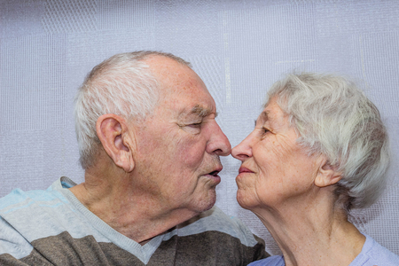 Happy senior old man and woman embracing, romantic family couple, love care devotion in senior people marriage