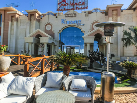 Sharm El Sheikh, Egypt - December 31, 2018: The main entrance to the luxury hotel Xperience Sea Breeze Resort . Hotel employee accepts luggage of tourists.