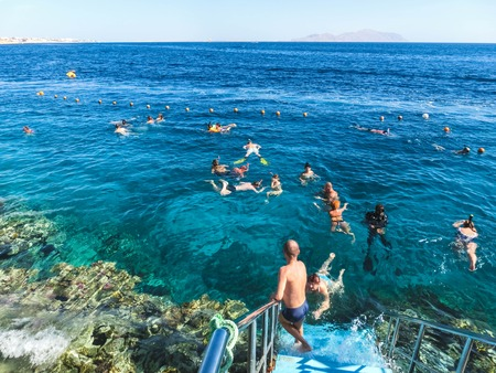 Sharm El Sheikh, Egypt - December 31, 2018: The people snorkeling in blue waters above coral reef on red sea in Sharm El Sheikh, Egypt. People and lifestyle concept Redactioneel