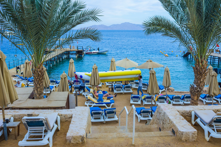 Sharm El Sheikh, Egypt - December 31, 2018: The people at Red sea beach with clean water at in Egypt, Sharm el-Sheikh at sunny day