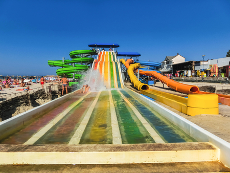 Iron Port or Zaliznyi Port, Kherson Oblast, Ukraine - August 26, 2018: The people at water rides and slides on the Black Sea coast at Iron Port or Zaliznyi Port, Kherson Oblast, Ukraine on August 26, 2018