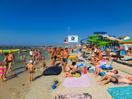 Iron Port or Zaliznyi Port, Kherson Oblast, Ukraine - August 26, 2018: The large crowd of people on the Black Sea coast. Redactioneel