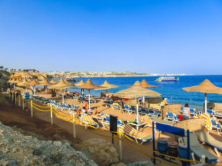 Sharm El Sheikh, Egypt - December 31, 2018: Red sea beach with clean water at in Egypt, Sharm el-Sheikh at sunny day