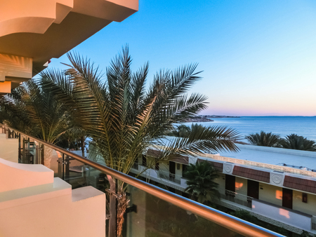 Sharm El Sheikh, Egypt - December 31, 2018:Tropical luxury Xperience Sea Breeze Resort on Red Sea beach. Palm trees and other landscaped trees on the background of a hotel buildings in Egypt, Sharm el-Sheikh Redactioneel