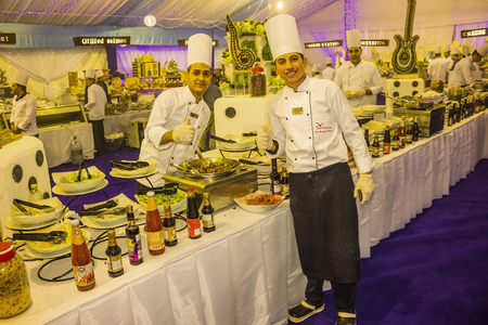 Sharm El Sheikh, Egypt - December 31, 2018: Egyptian cooks standing at hotel restaurant at Xperience Sea Breeze Resort . Egyptian food is a mixture of all the different civilisations that came to Egypt in the history of its existence.