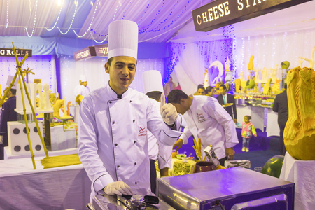 Sharm El Sheikh, Egypt - December 31, 2018: Egyptian cook standing at hotel restaurant at Xperience Sea Breeze Resort . Egyptian food is a mixture of all the different civilisations that came to Egypt in the history of its existence. Redactioneel