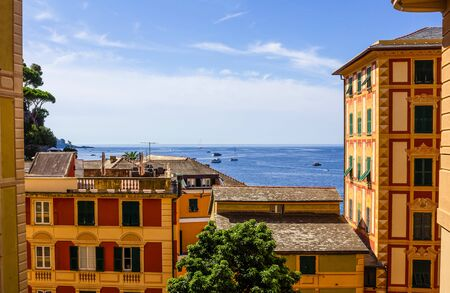 Colorful buildings and beach at Camogli on sunny summer day, Liguria