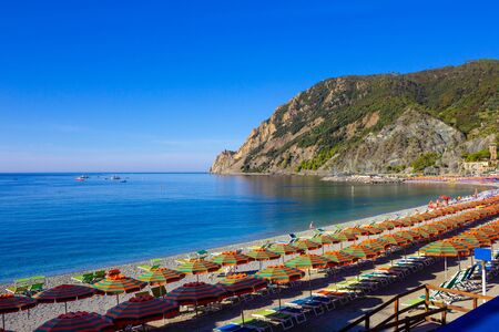 Panorama of Monterosso al Mare Beach, in summer season, a coastal village and resort in Cinque Terre, Liguria, Italy.