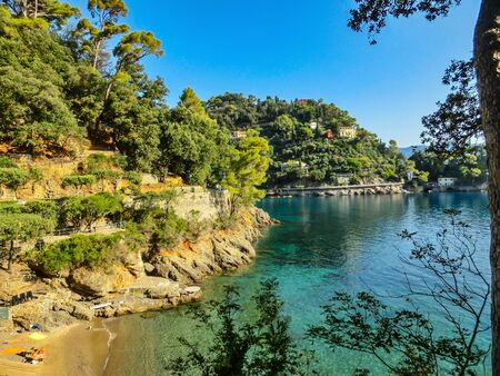 The sand beach known as paraggi near portofino in genoa on a blue sea background