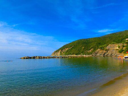 The coastline of Moneglia with the village on the sandy beach