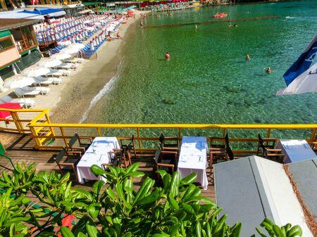 Portofino, Italy - September 16, 2019: beach known as paraggi near portofino in genoa on a blue sky and sea background