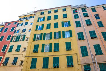 Facade of an old Italian building in old part of town, windows with shutters, old building in Genoa, Italy. 版權商用圖片